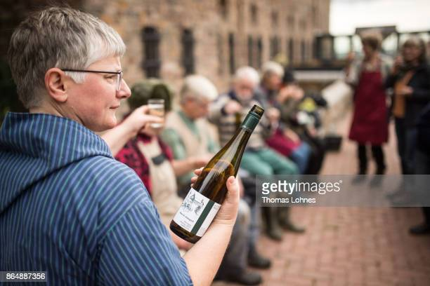 Nun Thekla of St Hildegard Abbey offers volunteers a glas wine during lunch break after harvesting grapes for their annual vintage on October 04 2017...