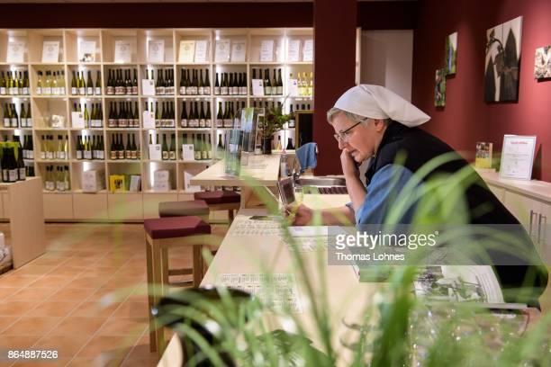 Nun Thekla of St Hildegard Abbey phones with a customer in store 'Vinothek' on October 20 2017 near Rudesheim on the Rhine Germany The St Hildegard...