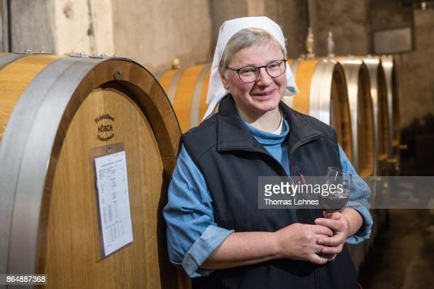 Nun Thekla of St Hildegard Abbey pictured with a Spaetburgunder red wine in the cellar on October 20 2017 near Rudesheim on the Rhine Germany The St...