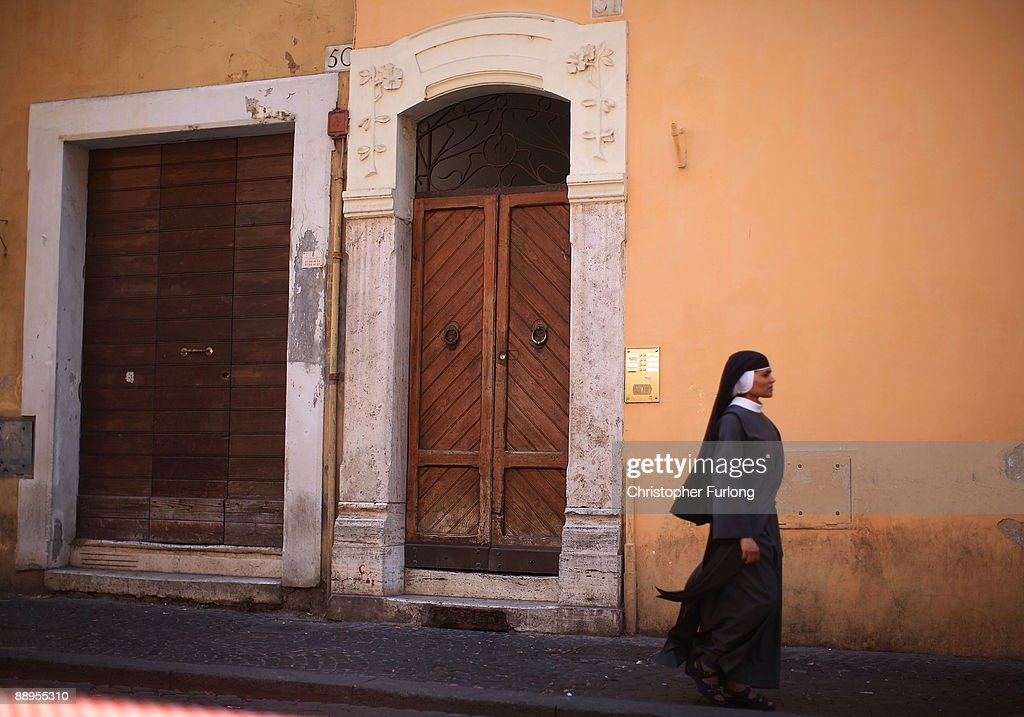 A nun walks along an Italian street on July 9, 2009 in Rome, Italy. With nearly 3000 years of history Rome continues to live up to its motto of The Eternal City being one of the founding cities of Western Civilisation.