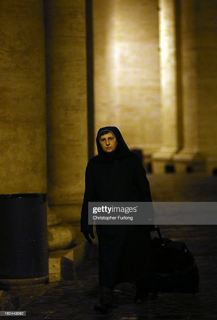 A nun walks along the collonade in Saint Peter's Square on February 23, 2013 in Vatican City, Vatican. Pope Benedict XVI is due to hold his last Angelus blessing tomorrow before he retires on Thursday. Pope Benedict XVI has been the leader of the Catholic Church for eight years and is the first Pope to retire since 1415. He cites his retirement due to ailing health and is to spend the rest of his life in solitude away from any public engagements.