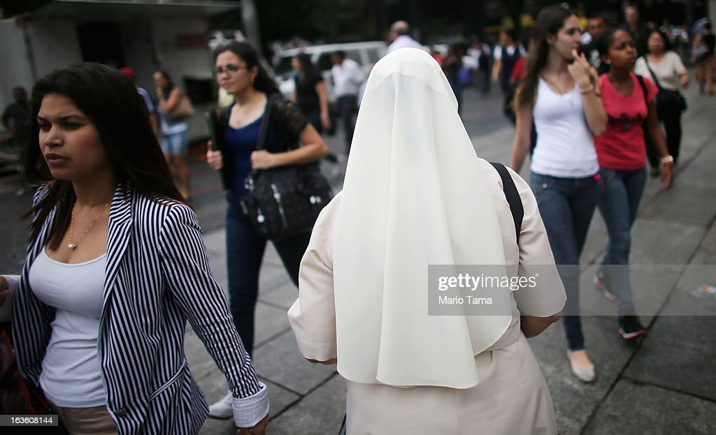 A nun walks past women outside the Se Cathedral, the cathedral of the Roman Catholic Archbishop of Sao Paulo, Cardinal Odilo Pedro Scherer, on March 13, 2013 in Sao Paulo, Brazil. Brazil has more Catholics than any other country in the world and supporters hope Sao Paulo Archbishop Cardinal Odilo Pedro Scherer will be chosen as the next Pope during the papal conclave.