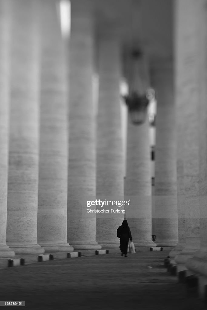 . A nun walks through the colonnade of St Peter's Square on March 15, 2013 in Vatican City, Vatican. Daily life continues around the vatican as romans prepare for the inauguration mass of Pope Francis, the first ever Latin American Pontiff.