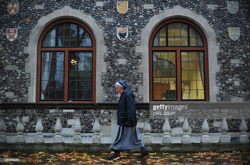 A nun walks to the venue of the three-day Church of England General Synod in central London on November 20, 2012, during which there will be a vote on whether to allow women to become bishops. The 470-member General Synod will vote on November 20 on the issue of women bishops which has split traditionalists and liberals, two decades after England's established state Church backed the introduction of women priests. AFP PHOTO / CARL COURT