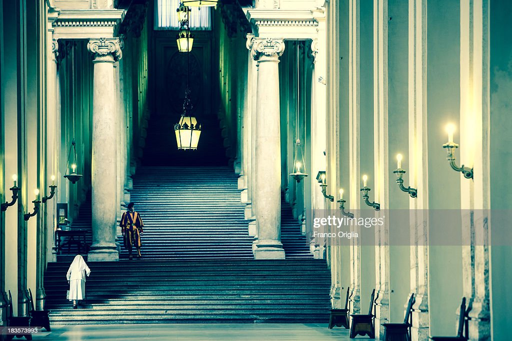 A nun walks up the stairs of the 'Scala Regia' at the Apostolic Palace on October 7, 2013 in Vatican City, Vatican. After the success of his Social networking accounts of Twitter and Facebook, Pope Francis joined Instagram, reporting today more than 8000 followers.