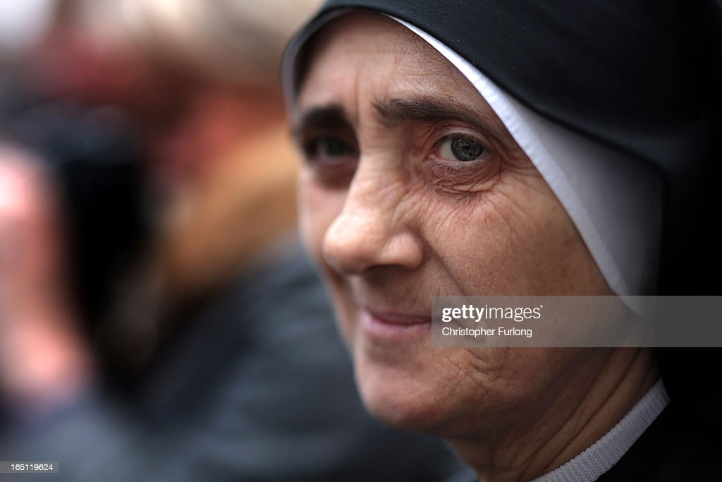 A nun watches Pope Francis deliver Mass prior to his first 'Urbi et Orbi' blessing from the balcony of St. Peter's Basilica during Easter Mass on March 31, 2013 in Vatican City, Vatican. Pope Francis delivered his message to the gathered faithful from the central balcony of St. Peter's Basilica in St. Peter's Square after his first Holy week as Pontiff.