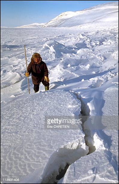Nunavik 'lnuits under the ice' In Nunavik Canada In December 2000Urpigak carefully checks if the cave is sturdy enough and if there are mussels at...
