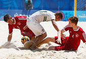 Nuno Belchior of Portugal battles with Glenn Hodel and Sandro Spaccarotella Switzerland during the Men's Beach Soccer bronze medal match between...