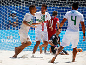 Nuno Belchior of Portugal celebrates with Jordan Santos as he scores their sixth goal during the Men's Beach Soccer bronze medal match between...