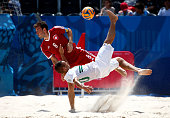 Nuno Belchior of Portugal is chalenged by Moritz Jaeggy of Switzerland during the Men's Beach Soccer bronze medal match between Switzerland and...