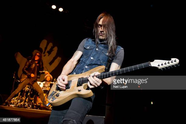 Nuno Bettencourt of Extreme performs on stage at The Forum on July 8 2014 in London United Kingdom