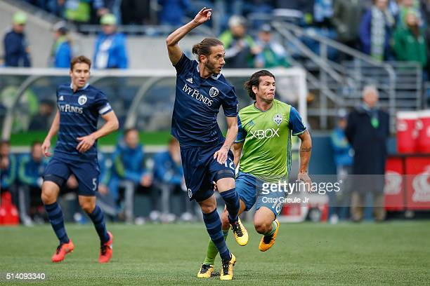 Nuno Coelho of Sporting Kansas City battles Nelson Valdez of the Seattle Sounders FC at CenturyLink Field on March 6 2016 in Seattle Washington...