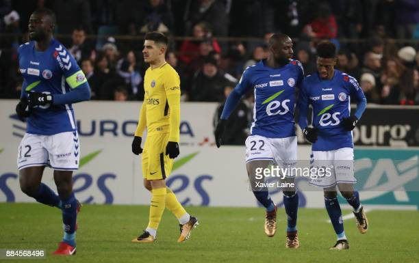 Nuno Da Costa of Strasbourg celebrate his goal with Ernest Seka Yuri Berchiche of PSG is disapointed during the Ligue 1 match between Strasbourg and...