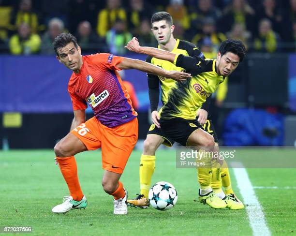 Nuno Miguel Barbosa Morais of APOEL Nicosia and Christian Pulisic of Dortmund and Shinji Kagawa of Dortmund battle for the ball during the UEFA...