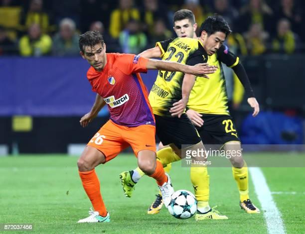 Nuno Miguel Barbosa Morais of APOEL Nicosia and Shinji Kagawa of Dortmund Christian Pulisic of Dortmund battle for the ball during the UEFA Champions...