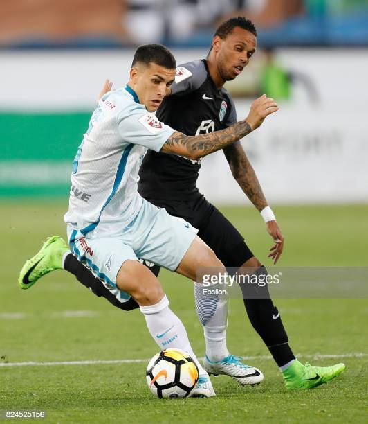 Nuno Rocha of FC Tosno and Leandro Paredes of FC Zenit Saint Petersburg vie for the ball during the Russian Football League match between FC Tosno...
