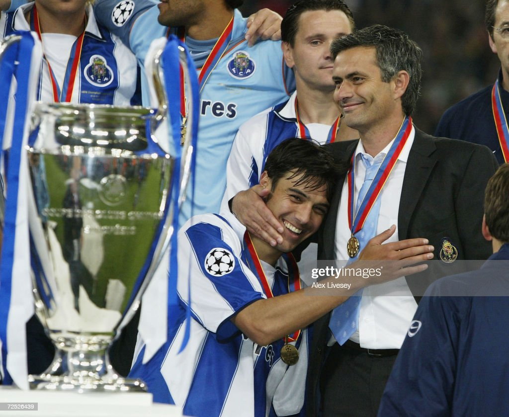 Nuno Valente of FC Porto hugs his manager Jose Dos Santos Mourinho after winning the Champions League during the UEFA Champions League Final match between AS Monaco and FC Porto at the AufSchake Arena on May 26, 2004 in Gelsenkirchen, Germany.