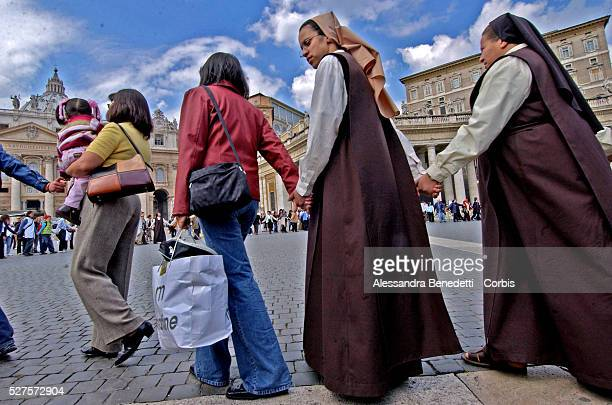 Nuns and Catholic faithfuls pray for Pope John Paul II in St Peter's Square Vatican spokesman Navarro Valls announced in today's bulletin that the...