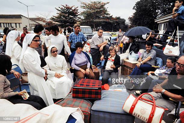 Nuns and European refugees and expatriates wait for their evacuation to Lisbon by a French plane on September 05 1975 at Luanda airport After...