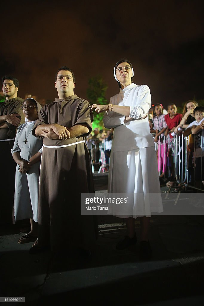 Nuns and monks watch a Good Friday performance of the life of Jesus following Mass at the Metropolitan Cathedral on March 29, 2013 in Rio de Janeiro, Brazil. Pope Francis is the first pope to hail from South America, with Brazilian Catholics set to receive the pontiff during his visit to Brazil in July for a Catholic youth festival. Brazil has more Catholics than any other country.