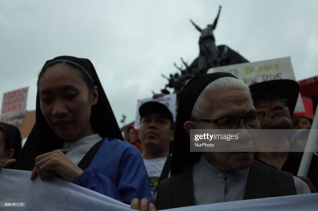 Nuns are seen during a rally against extrajudicial killings in Quezon City, east of Manila, Philippines on Monday, 21 August 2017. The death of Kian Delos Santos, who was killed by policemen in an alleged shootout, has sparked protests and condemnation from the public against alleged extrajudicial killings on drug users and pushers.