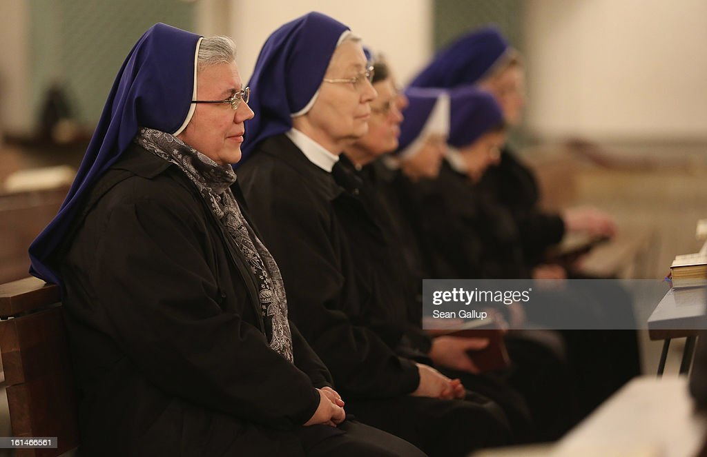 Nuns attend a special evening mass at St. Hedwig Catholic cathedral following the announced resignation of Pope Benedict XVI on February 11, 2013 in Berlin, Germany. Pope Benedict XVI, born Josef Ratzinger in Germany, announced to Vatican clergy on Monday that he feels too physically frail to continue meeting the demands of being the Pope and will step down officially on February 28.