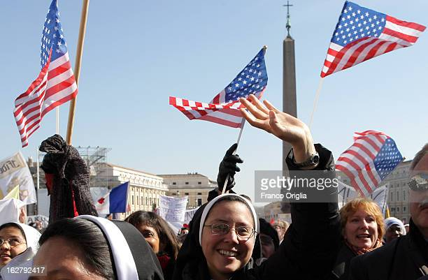 Nuns attend Pope Benedict XVI's final general audience in St Peter's Square on February 27 2013 in Vatican City Vatican The Pontiff attended his last...