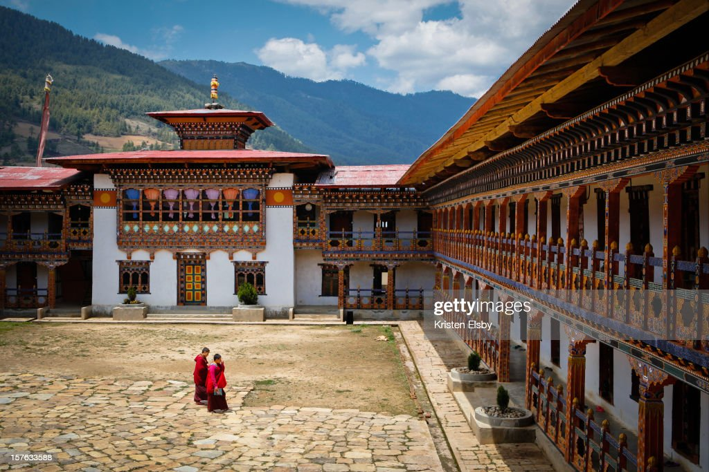 Nuns cross the courtyard of a remote nunnery in central Bhutan where around 100 Buddhist nuns reside.