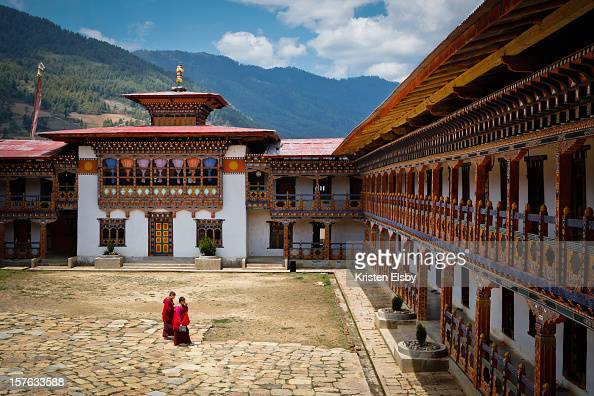 Nuns cross the courtyard of a remote nunnery in central Bhutan where around 100 Buddhist nuns reside