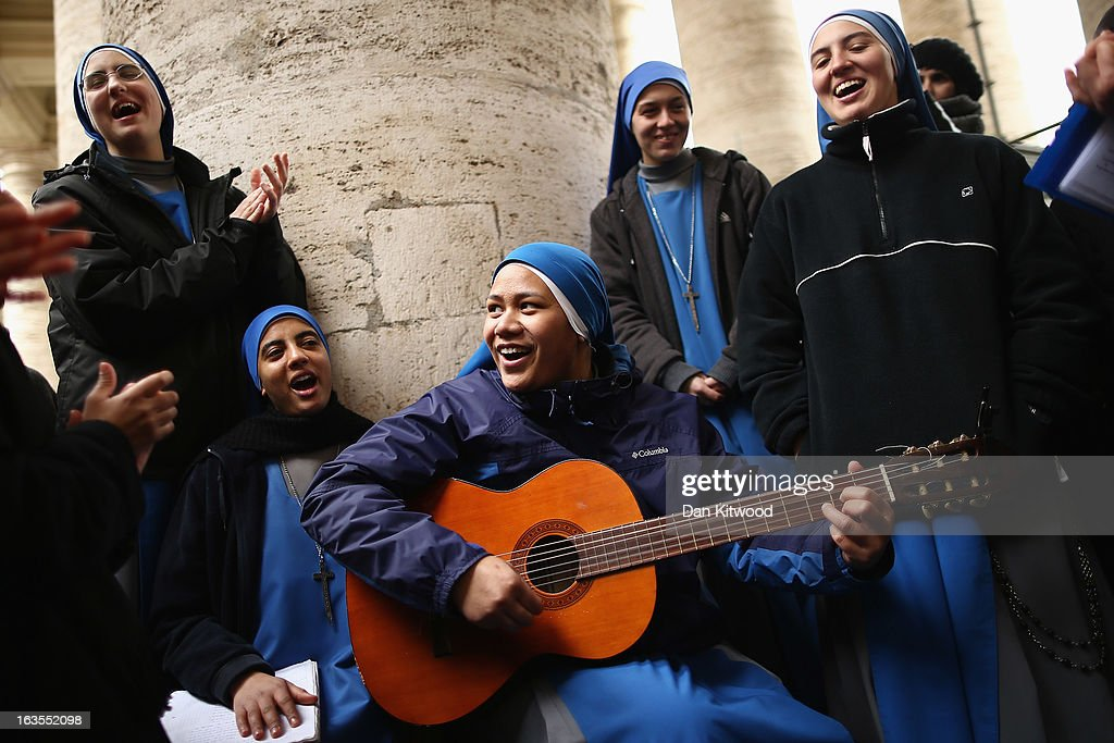 Nuns from the 'Instituto Serve del Signore, E Della Vergine Di Matara' sing hymns under the colonnade in St Peter's Square on March 12, 2013 in Vatican City, Vatican. Pope Benedict XVI's successor is being chosen by the College of Cardinals in Conclave in the Sistine Chapel. The 115 cardinal-electors, meeting in strict secrecy, will need to reach a two-thirds-plus-one vote majority to elect the 266th Pontiff.