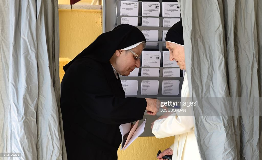Nuns gather election material to vote in Spains general election at the Bernadette college polling station in Moncloa-Aravaca, Madrid, on June 26, 2016. Spain votes today, six months after an inconclusive election which saw parties unable to agree on a coalition government. JORDAN