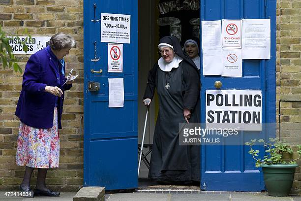 Nuns leave a polling station after voting in London on May 7 2015 as Britain holds a general election Polls opened today in Britain's closest general...
