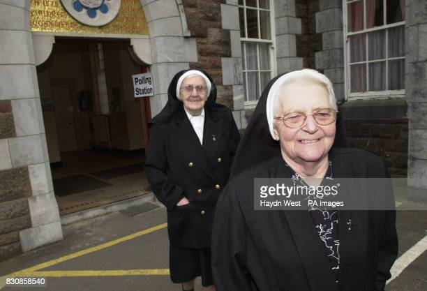 Nuns leaving a polling station at St John's Roman Catholic Church in Tralee Co Kerry after casting their votes in the Republic of Ireland's general...