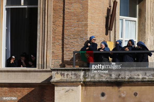 Nuns look on from a balcony during the Inauguration Mass for Pope Francis in St Peter's Square on March 19 2013 in Vatican City Vatican The mass is...