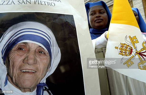 Nuns near the portrait of Mother Teresa during the beatification ceremony led by Pope John Paul II October 19 2003 in Vatican City Italy Mother...