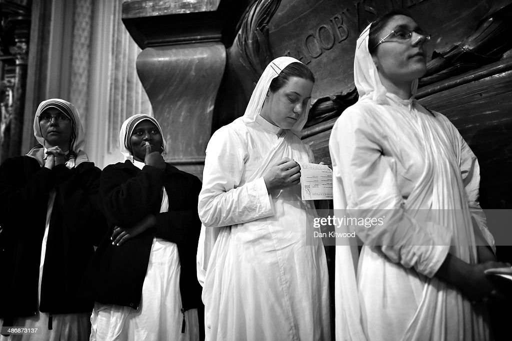 Nuns Pray in The basilica of St. John Lateran, the spiritual home of former Pope John XXIII, on April 26, 2014 in Rome, Italy. Dignitaries, heads of state and Royals, from Europe and across the World, are gathering in the Vatican ahead of tomorrows canonisations. The late Pope John Paul II and Pope John XXIII will be canonised on Sunday 27 April, inside the Vatican when 800,000 pilgrims from around the world are expected to attend.