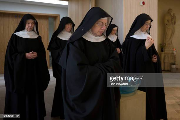 Nuns process to prayer at Stanbrook Abbey on May 8 2017 in Wass England Stanbrook Abbey is located in the North Yorkshire Moors National Park and...