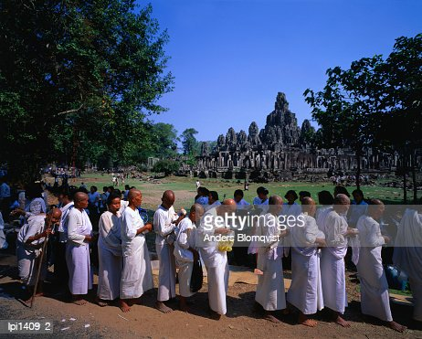 Nuns receiving alms at the Bayon Temple Festival at Angkor Thom, Angkor, Siem Reap, Cambodia, South-East Asia : Stock Photo