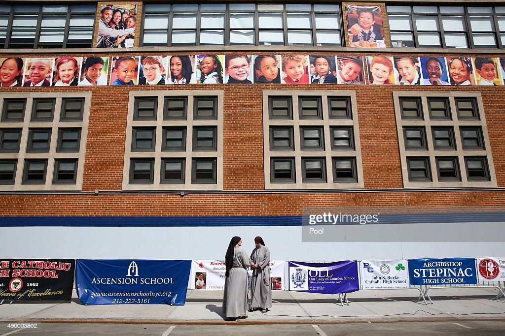 Nuns set up sound equipment outside prior to Pope Francis visiting Our Lady Queen of Angels School on September 25, 2015 in New York City. Pope Francis is on a six-day trip to the USA, which includes stops in Washington DC, New York and Philadelphia, after a three-day stay in Cuba.