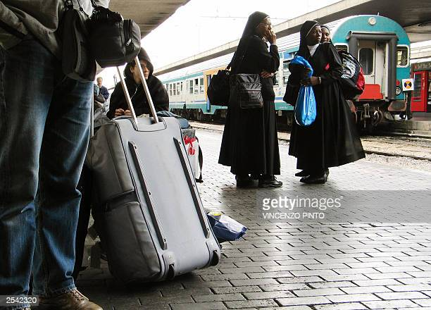 Nuns stand in the platform of Rome's Termini train station 28 September 2003 Italy was plunged into darkness early Sunday after a mammoth power...