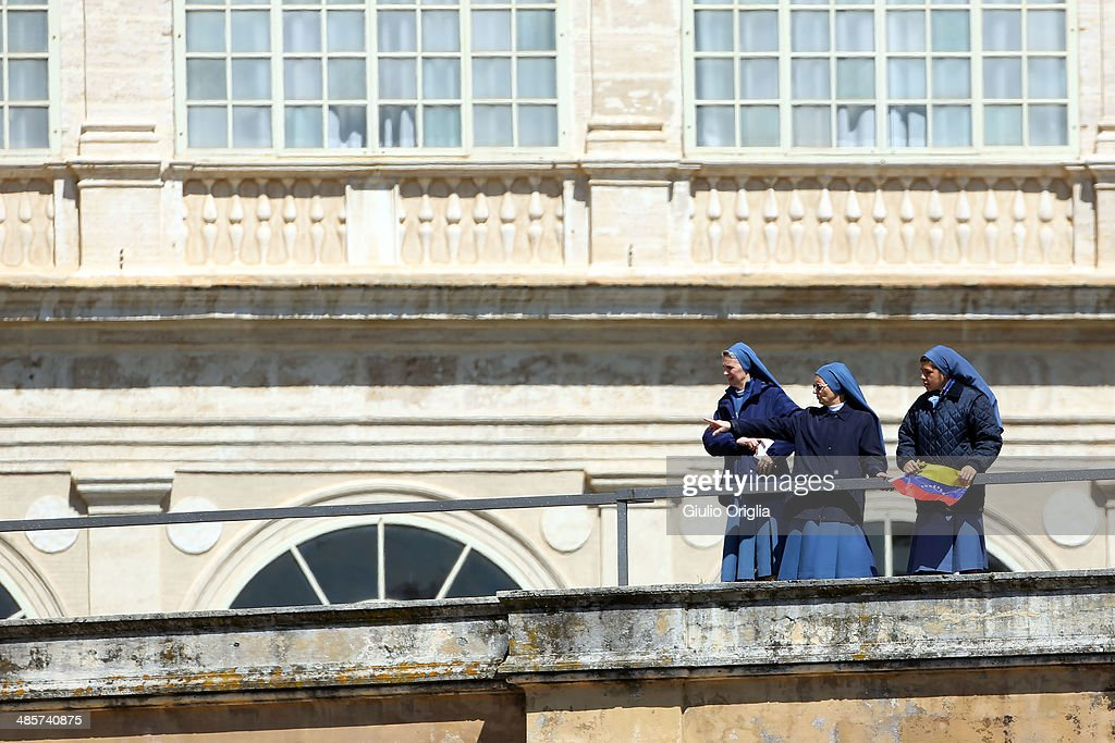 Nuns stand on St. Peter's colonnade as Easter Mass is held by Pope Francis in St. Peter's Square on April 20, 2014 in Vatican City, Vatican. Pope Francis is attending the Holy Week for his second time as a Pontiff. Using the global twitter network, yesterday he asked people worldwide to join him in prayer for the victims of the tragic ferry disaster in South Korea.
