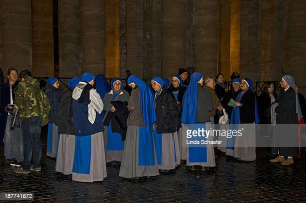 CONTENT] Nuns waiting in line for Christmas Eve Mass at St Peter's Cathedral for the time when the Swiss Guards allow the crowds who have tickets to...