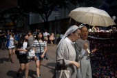 Nuns walk on a popular shopping street in Seoul on July 6 2013 Freedom of religion is constitutionally guaranteed in South Korea which is...