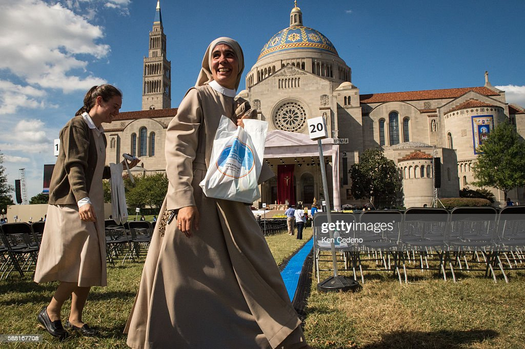 Nuns walk through the grounds where Pope Francis will conduct mass and the Canonization of Blessed Junipero Serra at the Basilica of the National...