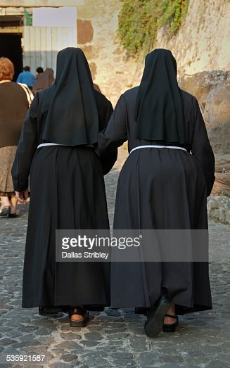Nuns walking to church in Lipari, Sicily : Stock Photo
