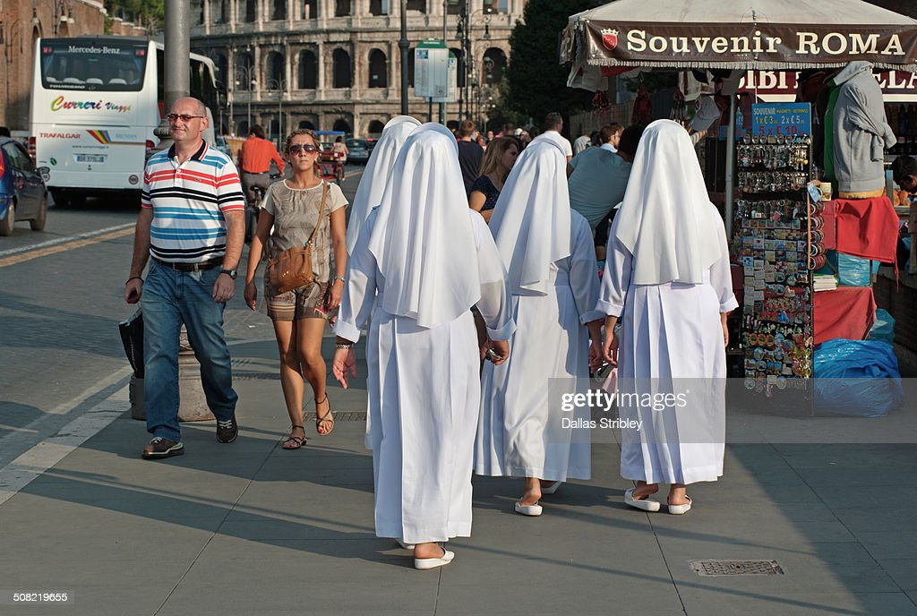 Nuns walking to the Colosseum, Rome, Italy