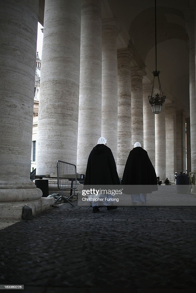 Nuns walks through the collonade of St Peter's Square as cardinals arrive for their eighth congregation at the Paul VI Hall inside the Vatican on March 8, 2013 in Vatican City, Vatican. Cardinals are set to enter the conclave to elect a successor to Pope Benedict XVI after he became the first pope in 600 years to resign from the role. The conclave is scheduled to start on March 12 inside the Sistine Chapel and will be attended by 115 cardinals as they vote to select the 266th Pope of the Catholic Church.