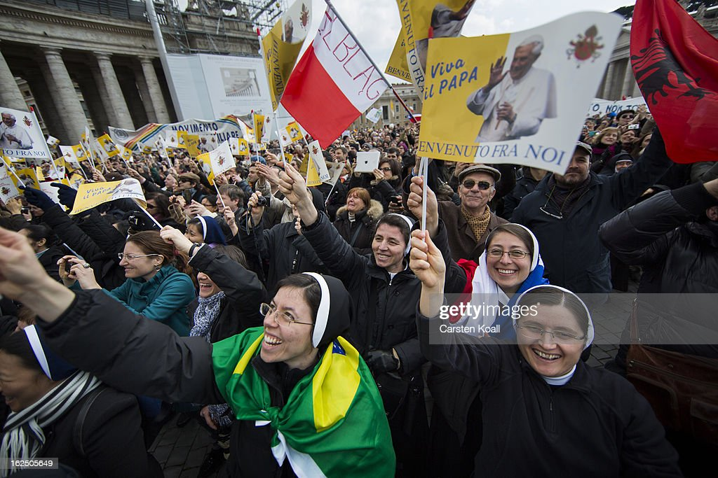 Nuns wave as they gather to watch Pope Benedict XVI deliver his last Angelus Blessing on February 24, 2013 in Vatican City, Vatican. Pope Benedict XVI delivers his last Angelus Blessing from the window of his private apartment to thousands of pilgrims gathered in Saint Peter's Square on February 24, 2013 in Vatican City, Vatican. The Pontiff will hold his last weekly public audience on February 27, 2013 before he retires the following day. Pope Benedict XVI has been the leader of the Catholic Church for eight years and is the first Pope to retire since 1415. He cites ailing health as his reason for retirement and will spend the rest of his life in solitude away from public engagements.