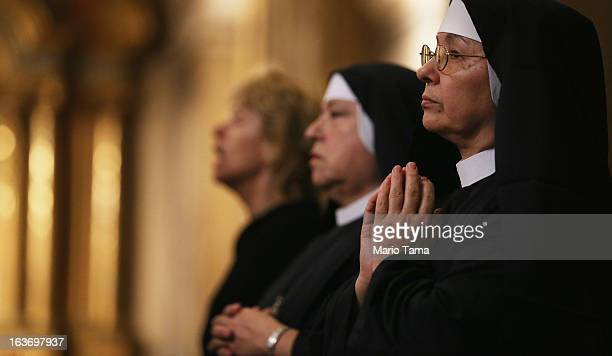 Nuns worship in the Metropolitan Cathedral during Mass on the day after Pope Francis was elected at the conclave on March 14 2013 in Buenos Aires...