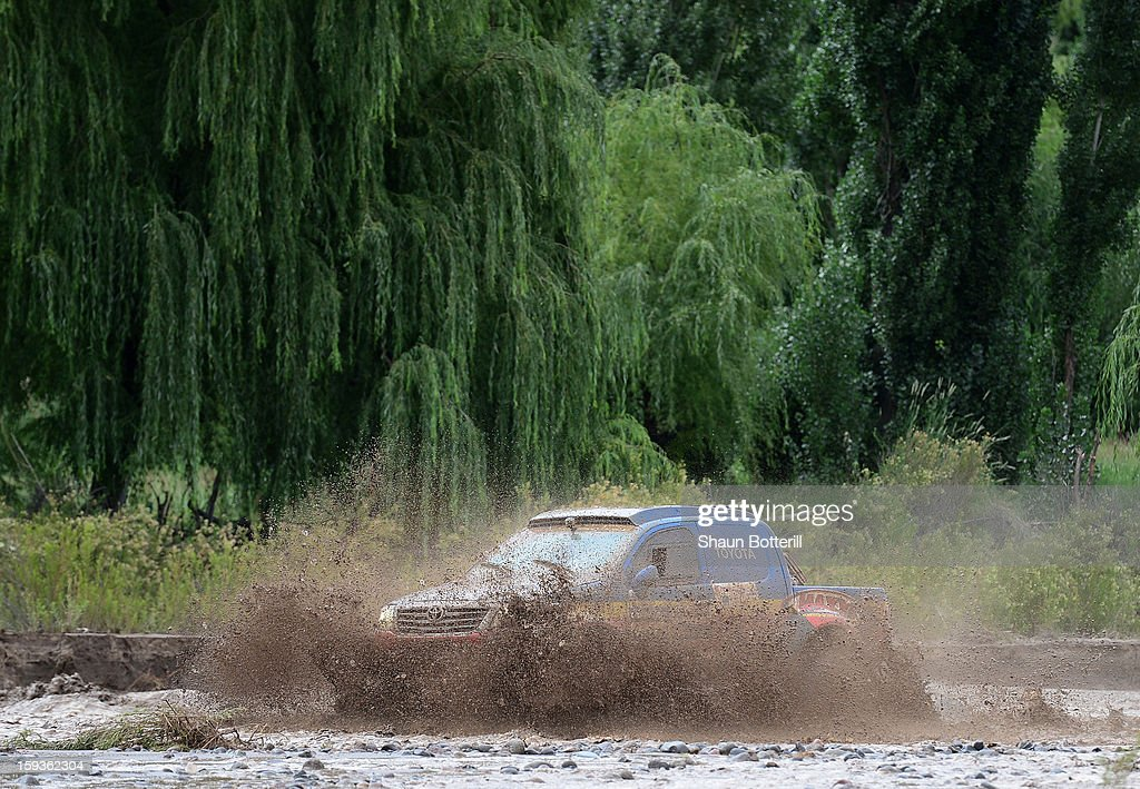 Nunzio Coffaro and co-driver Daniel Meneses makes his way through a river after the stage from Salta to Tucuman was interupted by a flash flood during the 2013 Dakar Rally on January 12, 2012 in Salta, Argentina.